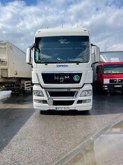 camião com lona deslizante MAN TGX 24.440 + reboque com cortina lateral