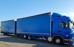 camião com lona deslizante SCANIA R440. Jumbozug. 119 m3 + reboque com cortina lateral