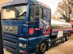 camião de transporte de leite MAN TGA 26.410